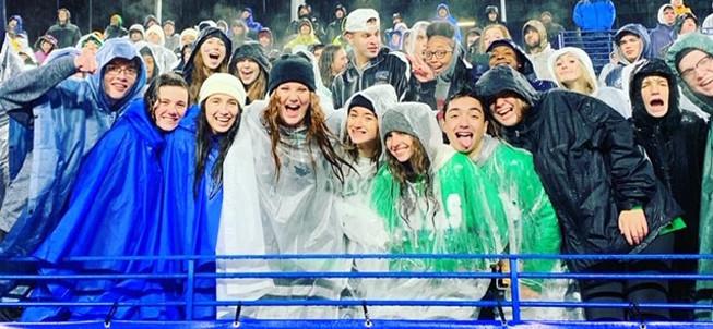 Football fans in the rain