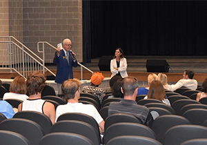 Cobb Juvenile Court Judge Jeff Hamby discusses the dangers of vaping during his presentation in an auditorium