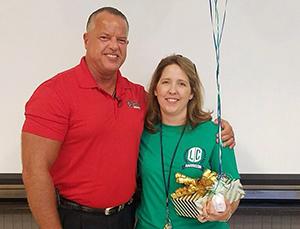 Rachael Sanford posing as she wins the Teacher of the Year Award