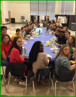 Harrison students gathered around a large table