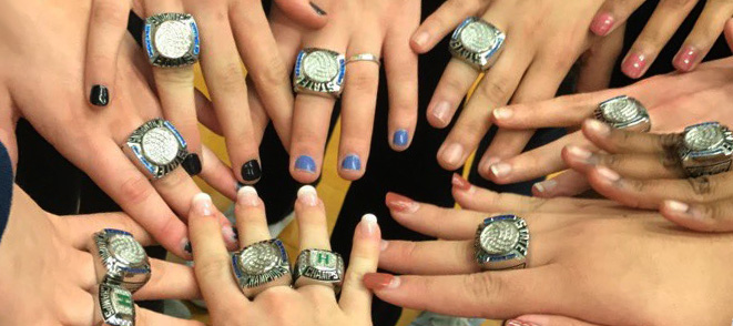 Students hands with school rings