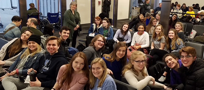 Students in an airport waiting area