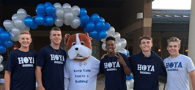 Male Hoya students pose with the Harrison High bulldog mascot