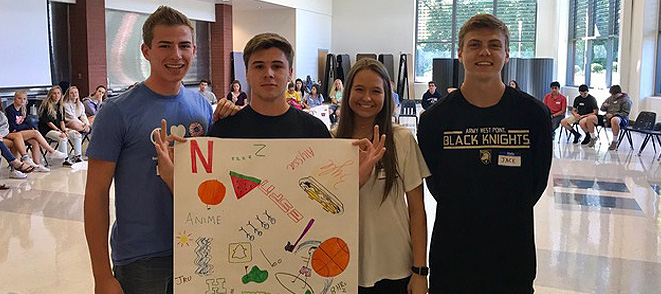 Students holding a sign