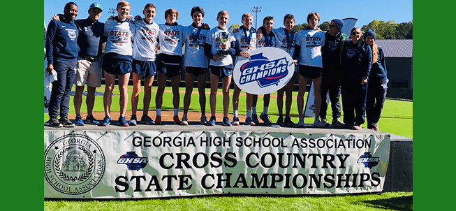 Georgia High School Association Cross Country State Championships champions pose together outside