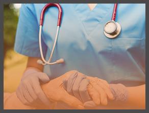 nurse holding a patients hand