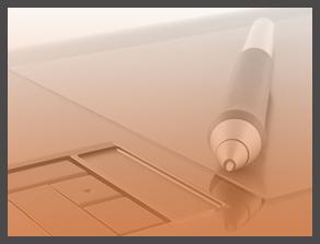 a pen on a laptop