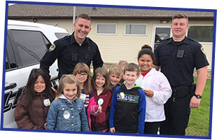elementary students with police officers