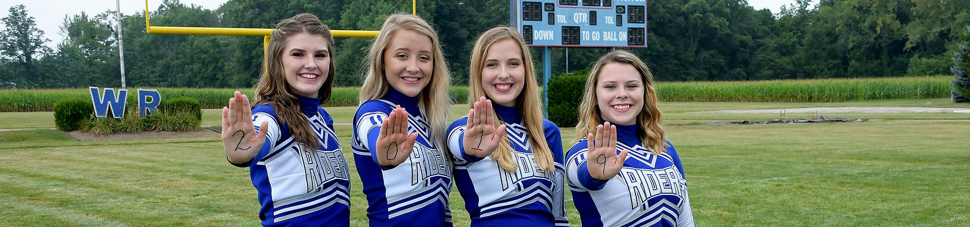 Four happy western reserve cheerleaders