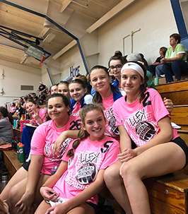 Group of happy high school girls in pink t-shirts