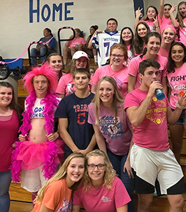 Group of spirited high school students in pink at a game