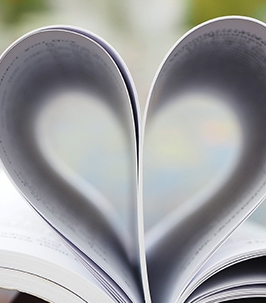 School book with pages wrapped in the shape of a heart