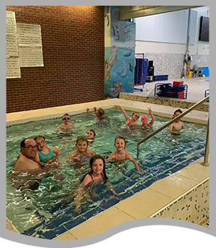 Students and parents swimming in a pool