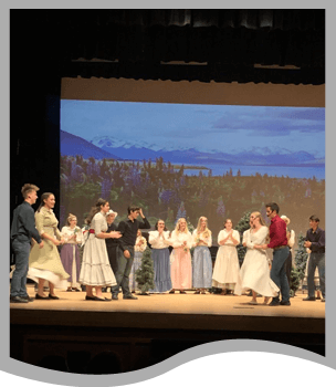 Students performing Seven Brides for Seven Brothers play