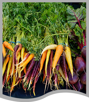 Two male students pose with plates of food
