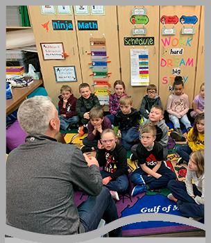 Teacher talks to students
