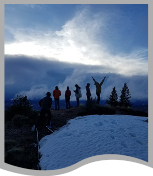 Students stand on a snowy mountain