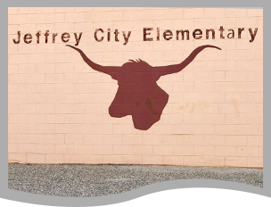 Jeffrey City Elementary sign and longhorn outline on a brick wall