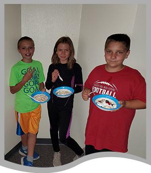 Three students enjoying a treat