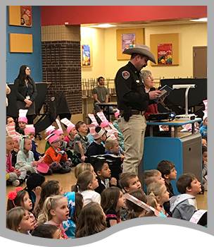 Police officer reads to students