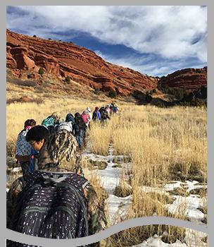 Students walk toward a canyon