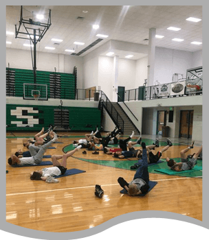 Students participate in a yoga class