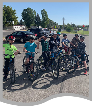 Middle school student outside with their bike team