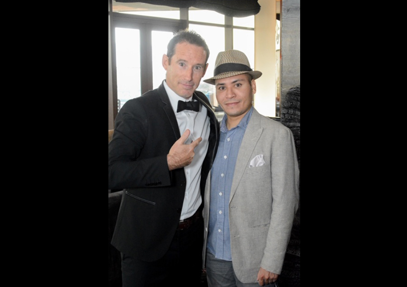Patrick in tux next to man in hat