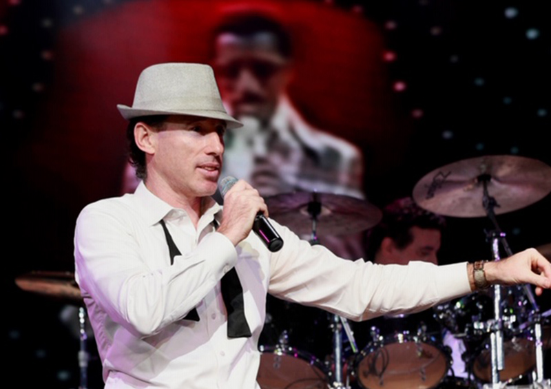 Patrick in hat with microphone
