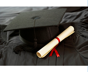 Graduation cap and gown and diploma