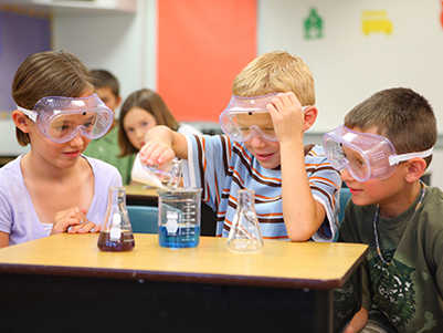 three students working on a science project