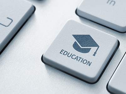 keyboard with a key that says Education with a graduation cap on it