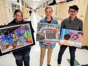 Smethport High School students proudly holding up their artwork at the art show