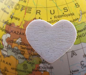 Felt-shaped heart on a globe