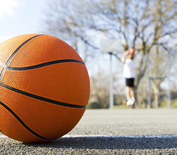 Close-up of a basketball on an outside court