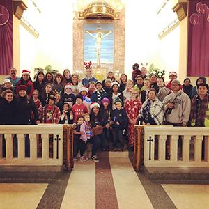 Christmas carolers pose in church