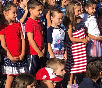 Students wearing red, white, and blue