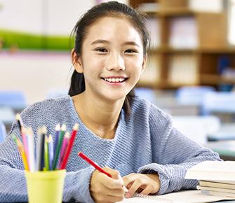 girl doing her school work at her desk