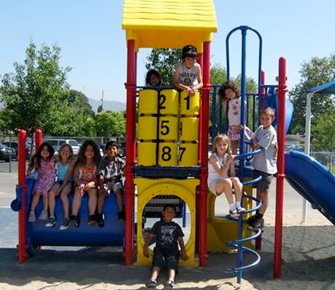 students on playground equipment