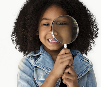 little girl holding a magnify glass to her eye