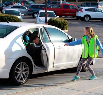 student helping another student exit their car