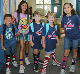 five students wearing crazy socks