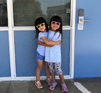 two girls wearing sunglasses