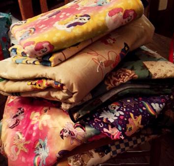 stack of children's blankets