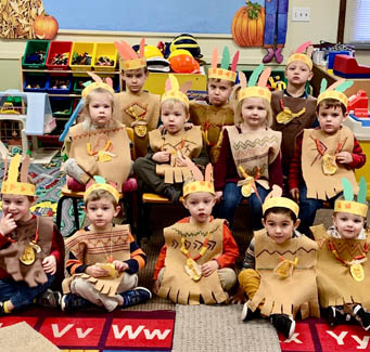 children dressed for Thanksgiving