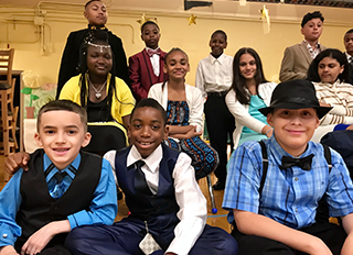 Students dressed in fancy attire pose together