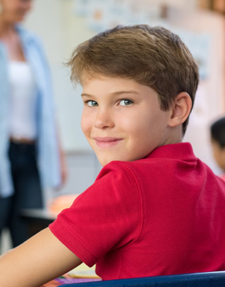 Smiling student looking over his shoulder