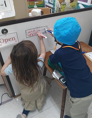 children at whiteboard