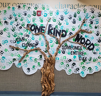 Paper tree that reads One kind word can change someones entire day.