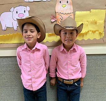 Two students dressed as farmers.